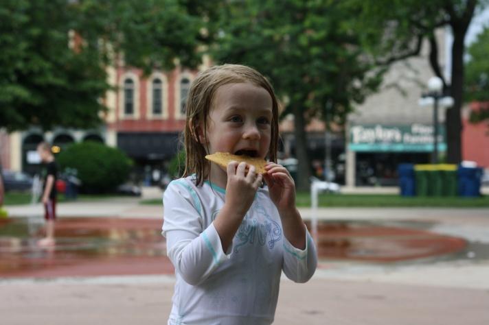 Emma enjoying a cookie in Washington Park.