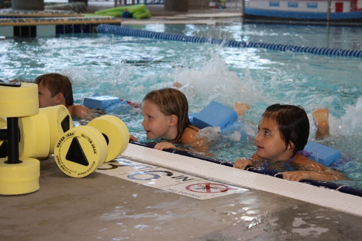 The girls finished swimming lessons last week.  Here's Sofia making waves!